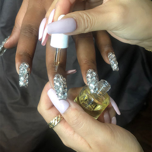 Lizzo wearing OPI at the AMAs!