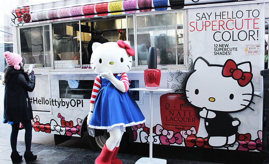Hello Kitty strikes a pose in front of the Hello Kitty by OPI food truck
